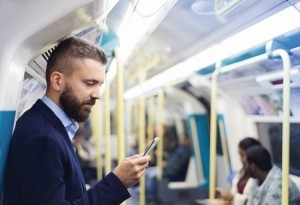 46625089 - young handsome businessman with smartphone in subway