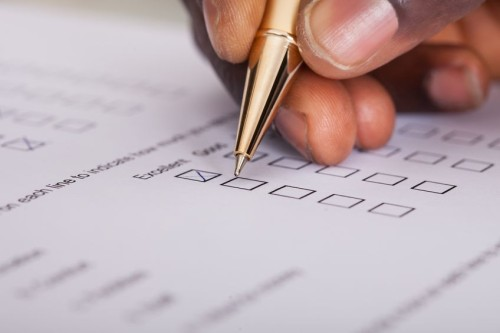 25155431 - close-up of businessman filling customer survey form