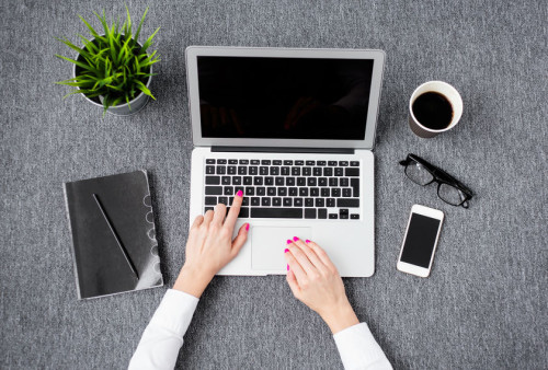 37177040 - young professional woman working with computer